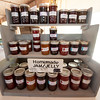 Homemade jams and jellies fill the shelves at the Fairhaven Berry Farm and Gardens booth on Thursday afternoon at the Webb City Farmers Market. The market is open of Tuesdays, Thursdays and Saturdays.<br /> Globe | Laurie Sisk