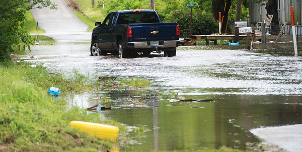 Globe/Roger Nomer<br /> A car drives through floodwaters in Kendricktown on Sunday afternoon.