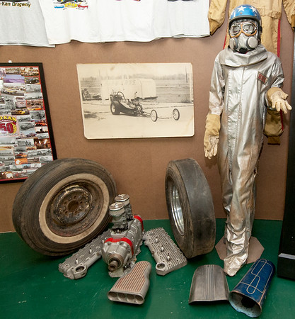 Old racing tires, flathead engine parts and an old driver's suit add a sense of history to the Mo-Kan exhibit at the Crawford County Historical Museum.<br /> Globe | Laurie Sisk