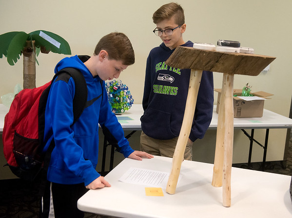Globe/Roger Nomer<br /> Klayton Kollmeyer, right, and Landon Parker, both seventh graders at Carthage Junior High, look at recycled crafts on Tuesday at Missouri Southern.
