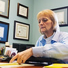 Globe/Roger Nomer<br /> Kathleen Burr-Blood prepares taxes on Tuesday at Blood Tax Service.