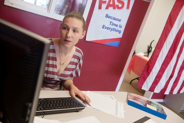 Globe/Roger Nomer<br /> Rheannen Owens, a tax preparer at Liberty Tax on Main Street, works on taxes on Tuesday.