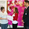 Globe/Roger Nomer<br /> Sharon Clark, president of Hope 4 You Breast Cancer Foundation, presents a check for $5,000 to Wendy Chrisenbery, supervisor of the Wes and Jan Houser Women's Pavilion and Blake Bard, chief development officer for Freeman Health System, on Friday at the women's center. The funds were raised through several events including pink bagels at Panera Bread, the Race 4 You run and donations from an event organized by students at Carl Junction High School.