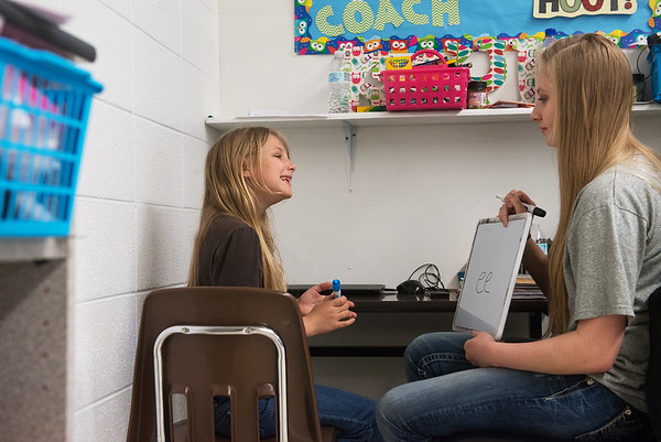 Globe/Roger Nomer<br /> Kayla Boggs quizzes Harley Eden, second grade, on Monday at Purdy Elementary.