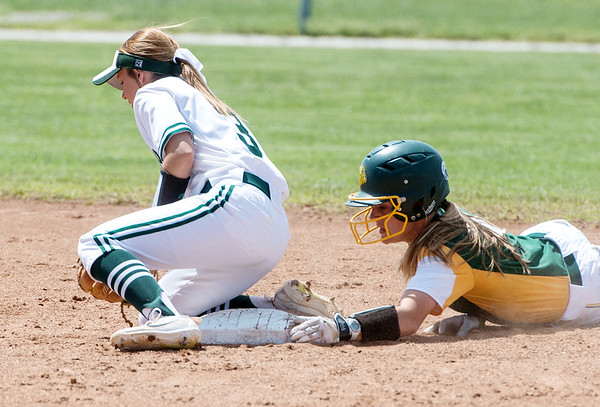 Globe/Roger Nomer<br /> Missouri Southern's Abi Corbett grabs the edge of the bag to slide safely into second behind Northwest Missouri's Kiana Baderdeen on Monday at MSSU.