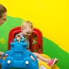 Globe/Roger Nomer<br /> Brittany Hoth, teachers aide, helps Alizabeth Jenkins, 2, with the slide on Wednesday at the Cerebrap Palsy of Tri-County center in Webb City.