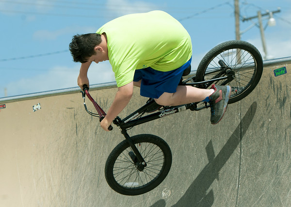 Travis Woods, 13, perfects a 180 while riding at the Ewert Skate Park on Wednesday afternoon.<br /> Globe | Laurie Sisk