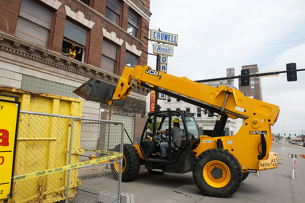 Globe/Roger Nomer<br /> Demolition work continues on Tuesday at the Crowell Pharmacy building in downtown Pittsburg for the Block 22 project.
