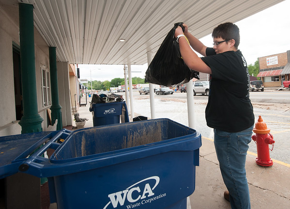 Sixteen-year-old Jacob Steele helps Sunday with cleanup at the Campbell-Biddlecome Funeral Home in Seneca after heavy flooding this weekend.<br /> Globe | Laurie Sisk