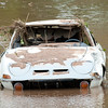 A vehicle, battered by flood waters remains in the area of Indian Creek on Sunday in Anderson.<br /> Globe | Laurie SIsk