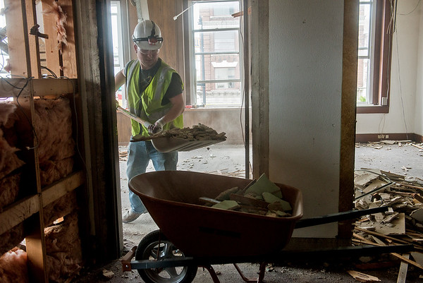 Globe/Roger Nomer<br /> Nick Cleghorn does demolition work at Fourth and Broadway in Pittsburg on Tuesday for the Block 22 project.