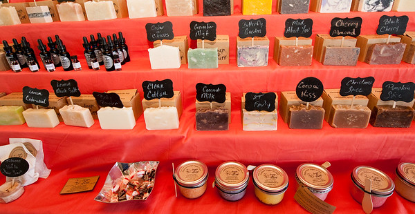 Homemade soaps and oils line the shelves of 2T's Soap and Stuff on Thursday afternoon at the Webb City Farmers Market. The market is open of Tuesdays, Thursdays and Saturdays.<br /> Globe | Laurie Sisk