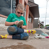 Eleven-year-old Makayla Dorris changes shoes in preparation for cleaning the Jailhouse Saloon after it flooded this weekend in downtown Seneca.<br /> Globe | Laurie Sisk
