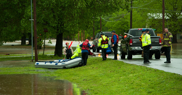 Emergency crews wrap up their search and rescue efforts at a staging area near Neosho's Morris Park on Saturday after heavy rains Friday night and Saturday caused massive flooding in the area.<br /> Globe | Laurie Sisk
