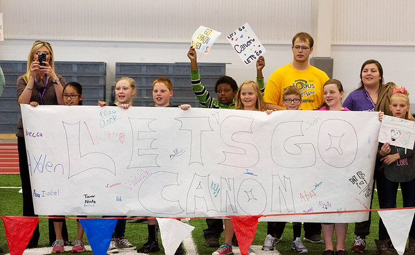 Globe/Roger Nomer<br /> Students from George Nettles Elementary cheer on their classmate Canon during Thursday's Kansas Southeast Region Special Olympics Spring Games at Pittsburg State's Plaster Center.