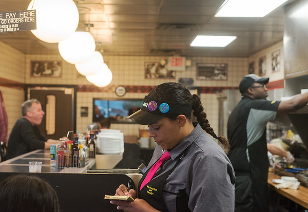 Globe/Roger Nomer<br /> Donelle Chasten takes an order on Friday at the Waffle House on South Range Line.