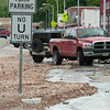 Piles of rock washed up by heavy flooding line the streets of downtown Seneca on Sunday.<br /> Globe | Laurie Sisk