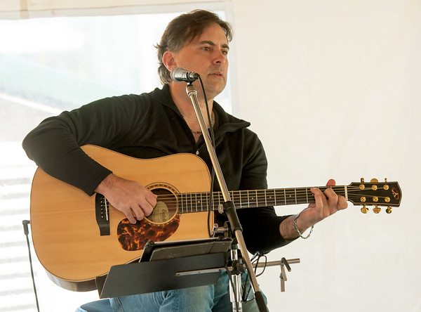 Scott Eastman entertains guests on Thursday afternoon at the Webb City Farmers Market. The market is open of Tuesdays, Thursdays and Saturdays and features live entertainment on a regular basis.<br /> Globe | Laurie Sisk