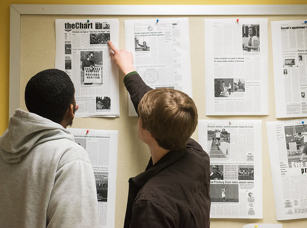 Globe/Roger Nomer<br /> Missouri Southern juniors Kelvin Duley II, left, sports editor, and Jack Girard, managing editor, proof pages on Thursday.