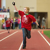 Globe/Roger Nomer<br /> Drake Eschbaumer, 11, Fort Scott, gives a thumbs up to the cheering crowd as he finishes his race during Thursday's Kansas Southeast Region Special Olympics Spring Games at Pittsburg State's Plaster Center.