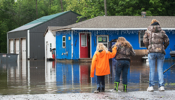 Globe/Roger Nomer<br /> Avery, 6, left, and Issy, 10, Snethen look at floodwaters with their grandmother Lora West as water surrounds their house in Kendricktown on Sunday.