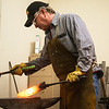 Globe/Roger Nomer<br /> Paul Brown shapes a knife while working Friday in his Carthage studio.