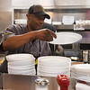 Globe/Roger Nomer<br /> Kenneth Cade stacks plates on Friday at the Waffle House on South Range Line.