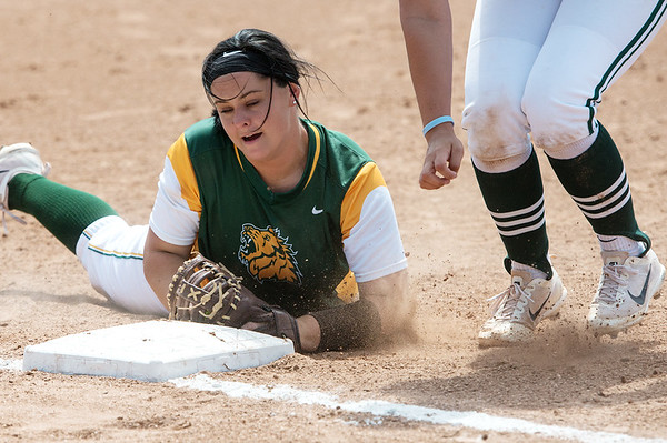 Globe/Roger Nomer<br /> Missouri Southern's Erika Lutgen dives back to first base after catching a fly to complete a double play against Northwest Missouri during Monday's game.