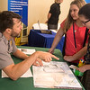 Globe/Roger Nomer<br /> Olivia Enlow, center, and Kate Tyler, seventh graders at Neosho Junior High, talk with Randall Becker, supervisor and park ranger at George Washington Carver National Monument, on Tuesday at Missouri Southern.