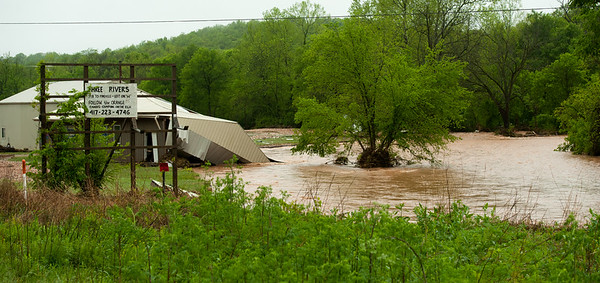 Flood waters reak havoc on a building near Anderson on Saturday after heavy rains Friday night and Saturday caused massive flooding in the area.<br /> Globe | Laurie Sisk