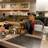 Globe/Roger Nomer<br /> Donelle Chasten serves an order on Friday at the Waffle House on South Range Line.
