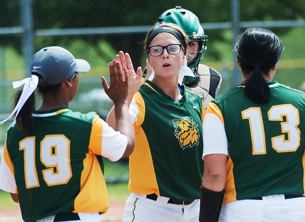Globe/Roger Nomer<br /> Missouri Southern's Sydney Koch exchanges high fives after striking out at Northwest Missouri batter to end the inning on Monday.