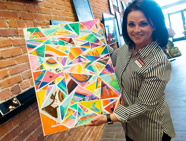Stephanie Freed, executive director of Rapha House, talks about artwork made by children in a safe house in Haiti.<br /> Globe | Roger Nomer