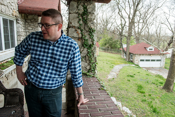 Michael Patterson talks about the land surrounding his house during an interview on Friday.<br /> Globe | Roger Nomer
