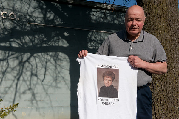 Audie Dennis holds a t-shirt honoring his aunt Norma Jean Johnson that he wore when he ran the Oklahoma City Marathon.<br /> Globe   Roger Nomer