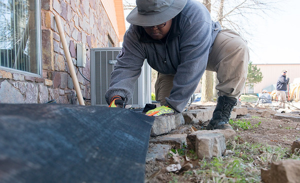 AmeriCorps National Civilian Community Corps member Sunsarrae Rapier, Morganfield, Ky. works on a landscaping project at the Bluejacket Building in Seneca on Monday.<br /> Globe   Roger Nomer