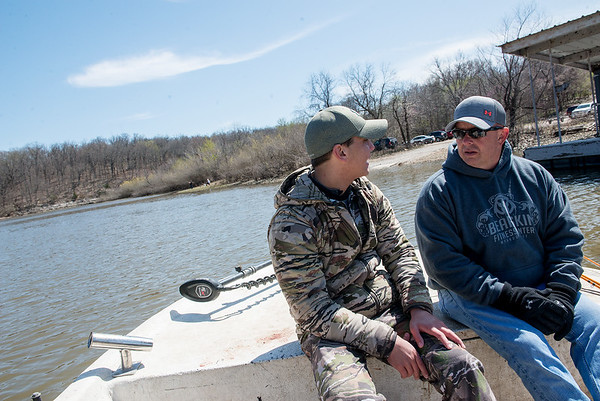 Kyle Green, left, talks with Billy Friend, chief of the Wyandotte Nation, while fishing on the Neosho River on Wednesday. Globe | Roger Nomer