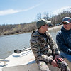 Kyle Green, left, talks with Billy Friend, chief of the Wyandotte Nation, while fishing on the Neosho River on Wednesday.<br /> Globe | Roger Nomer