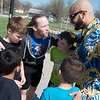 NWL wrestlers Jax Royal, left, and Rasheed Ali huddle up with their team before playing basketball at the Joplin Boys and Girls Club on Thursday.<br /> Globe | Roger Nomer