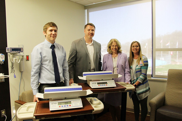 (left to right) Caleb Tidball, Cardinal Scale Marketing Coordinator; Jonathan Sabo, Cardinal Scale Vice President of Marketing and Customer Support; Paula F. Baker, Freeman President and Chief Executive Officer; Felicia Hall, Freeman Director of Maternal Services attend the donation of two baby scales to Freeman Health System from Cardinal Scale Manufacturing Company on Tuesday. The scales are state-of-the-art and will be placed in Freeman Pediatric Unit and Freeman Nursery.<br /> Contributed Photo