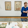 Sarah Buhr, curator, discusses items on display at the Springfield Art Museum by Rose O'Neill during an interview on Thursday.<br /> Globe | Roger Nomer