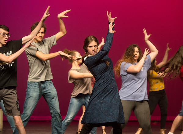 The cast of The Addams Family, including Chloe Brower as Wednesday, rehearse a scene from The Addams Family on Tuesday at Joplin High School.<br /> Globe | Roger Nomer