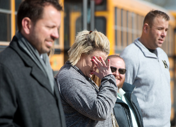 Goodman Elementary Principal Samantha Hamilton wipes away tears as staff remember the Goodman tornado during Wednesday's groundbreaking. Globe | Roger Nomer