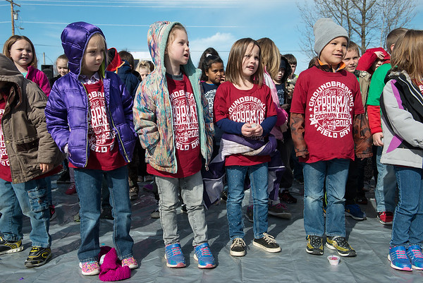 "Wearing t-shirts saying ""We're Back,"" Goodman Elementary students sing for the groundbreaking of their new school in Goodman on Wednesday.<br /> Globe 