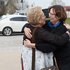 Lorene Bible, right, receives a hug and encouragement from Lisa Helm, a family friend, during a chance meeting outside the Craig County Sheriff Office on Thursday.<br /> Globe | Roger Nomer