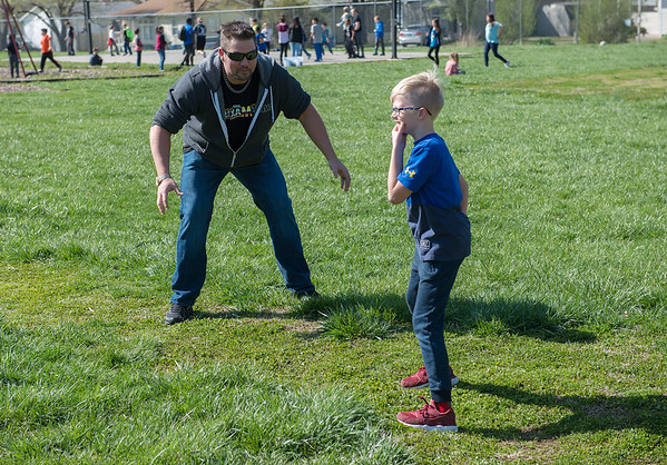 Barry Linduff, aka Flex Zerba, tries to intimidate Cooper Burrow, 10, on the basepath during a kickball game at the Joplin Boys and Girls Club on Thursday.<br /> Globe | Roger Nomer