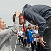 Claire Orscheln, Carthage High senior, presents Brandon Neal, 15, Boliver, with his medals during Wednesday's Special Olympics Missouri regional track and field meet at Haffner Stadium in Carthage.<br /> Globe | Roger Nomer