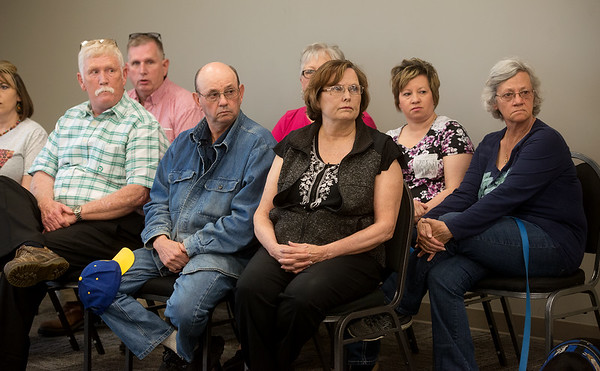 Family members listen during a press conference on Monday in Vinita.<br /> Globe | Roger Nomer
