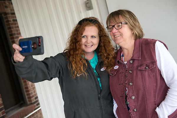 Tera Miller, left, and Martha Niess post a selfie with their voting stickers to encourage their friends to vote after voting on Tuesday at St. Paul's United Methodist Church. The duo took the selfie away from the polling place since selfies aren't allowed at the site. Globe | Roger Nomer