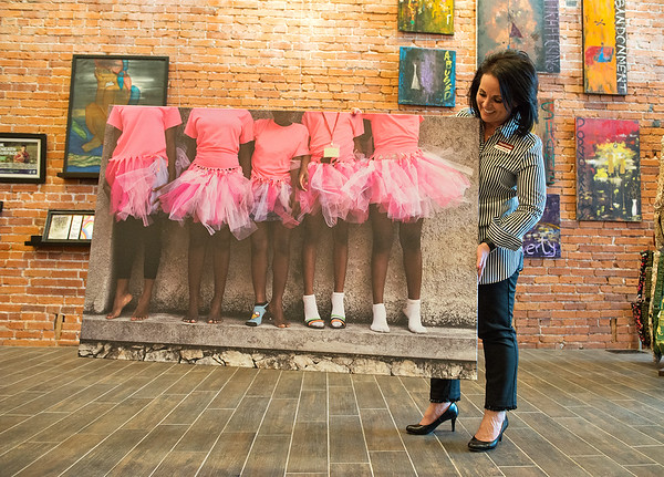 Stephanie Freed, executive director of Rapha House, talks about her favorite photo in the gallery at Rapha House in Joplin. The photo was taken by local artist Keona Quick of girls at a Rapha House safe house in Haiti.<br /> Globe   Roger Nomer